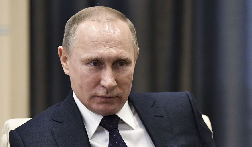 """Russian President Vladimir Putin listens during a meeting in Moscow, Russia, Monday, Feb. 6, 2017. The Kremlin is indignant over the comments of a Fox News journalist who called Russian President Vladimir Putin a """"killer"""" in an interview with President Donald Trump. (Alexei Nikolsky, Sputnik, Kremlin Pool Photo via AP)"""