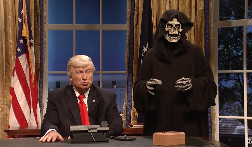 """Alec Baldwin, portraying President Trump, and an unnamed actor portraying Trump aide Stephen Bannon as the Grim Reaper are shown here from in a screen capture on the Feb. 4, 2017 edition of """"Saturday Night Live"""". (SNL/YouTube)"""