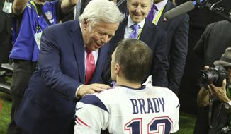 New England Patriots QB Tom Brady #12 is seen with owner Robert Kraft before the awards ceremony after beating the Atlanta Falcons at Super Bowl 51 on Sunday, February 5, 2017 in Houston, TX. (AP Photo/Gregory Payan)