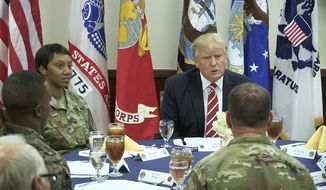 President Donald Trump talks with members of the military during a luncheon at U.S. Central Command at MacDill Air Force Base, Fla., Monday, Feb. 6, 2017. (James Borchuck/Tampa Bay Times via AP)