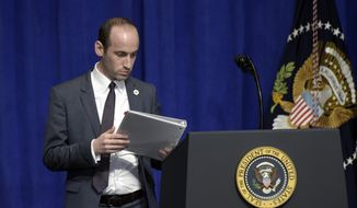 Senior policy adviser Stephen Miller places the remarks for President Donald Trump on the podium before Trump spoke to troops on a visit to U.S. Central Command and U.S. Special Operations Command at MacDill Air Force Base in Tampa, Fla., Monday, Feb. 6, 2017. (AP Photo/Susan Walsh)