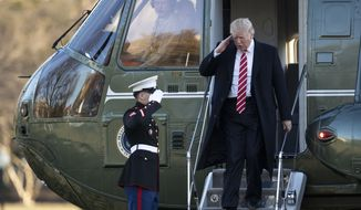 President Donald Trump salutes a Marines honor guard as he disembarks from Marine One upon arrival at the White House in Washington, Monday, Feb. 6, 2017 from a trip to Florida. (AP Photo/Manuel Balce Ceneta)