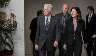 Supreme Court Justice nominee Neil Gorsuch, escorted by former New Hampshire Sen. Kelly Ayotte, arrives for a closed-door meeting with Sen. Jon Tester, D-Mont., at his office on Capitol Hill in Washington, Monday, Feb. 6, 2017. Tester is a Democrat running for re-election in a state that gave President Trump 56 percent of the vote. (AP Photo/J. Scott Applewhite)
