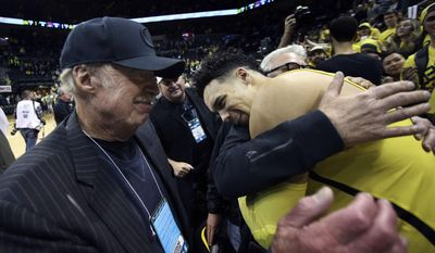 Nike co-founder Phil Knight, left, celebrates with Oregon's Dillon Brooks and fellow Duck fans after Oregon defeated Arizona in an NCAA college basketball game Saturday, Feb. 4, 2017, in Eugene, Ore. (AP Photo/Chris Pietsch)