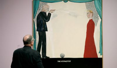 """A man looks at British artist David Hockney's """"The Hypnotist"""" during a media preview to promote the largest-ever retrospective of his work at Tate Britain gallery in London, Monday, Feb. 6, 2017. The exhibition, which opens to the public from February 9 and runs until May 29, celebrates the 79-year-old's achievement in painting, drawing, photography and video. (AP Photo/Matt Dunham)"""