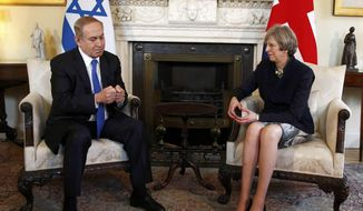 Britain's Prime Minister Theresa May, right, meets with Israeli Prime Minister Benjamin Netanyahu in Downing Street, London, Monday, Feb. 6, 2017. Israeli Prime Minister Benjamin Netanyahu met Prime Minister Theresa May in London on Monday for talks he hopes will focus on Iranian weapons, and not Israeli settlements. Britain, meanwhile, wants the talks at 10 Downing St. to discuss boosting trade ties between the two countries. (Peter Nicholls/Pool Photo via AP)