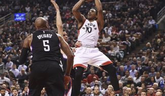Toronto Raptors guard DeMar DeRozan (10) shoots over LA Clippers centre Marreese Speights (5) during first half NBA basketball action in Toronto on Monday, Feb. 6, 2017. (Frank Gunn/The Canadian Press via AP)