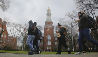 Students walk between classes at Brooklyn College in New York.  (AP Photo/Bebeto Matthews)