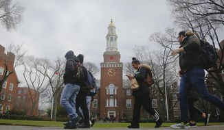 In this Wednesday Feb. 1, 2017, photo, Brooklyn College students walk between classes on campus in New York. They don't mean to sound ungrateful, but New York public college students who would stand to gain from the nation's most ambitious free-tuition proposal are quick to point out a sobering reality from their own meager finances: Free tuition doesn't mean free college. (AP Photo/Bebeto Matthews)