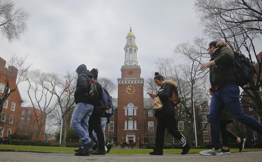 Students walk between classes at Brooklyn College in New York.  (AP Photo/Bebeto Matthews)