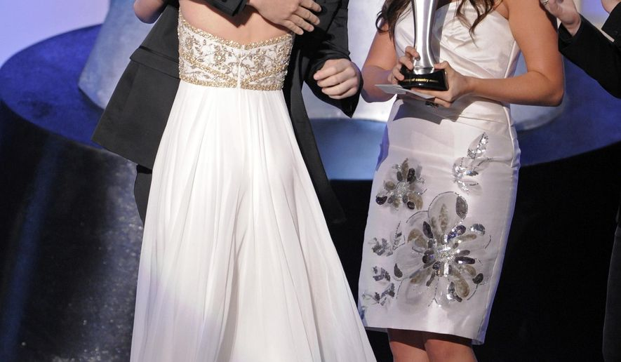 FILE - In this May 18, 2008, file photo, Lady Antebellum presents Taylor Swift the award for top new female vocalist at the 43rd annual Academy of Country Music Awards in Las Vegas. Swift has written hit songs for herself for years, but she recently lent her talent to others, from former boyfriend Calvin Harris to country act Little Big Town. And now Grammy-winning country group Lady A wants the Swift-song treatment. (AP Photo/Mark J. Terrill, File)