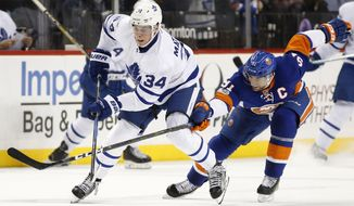 New York Islanders center John Tavares (91) defends Toronto Maple Leafs center Auston Matthews (34) during the first period of an NHL hockey game in New York, Monday, Feb. 6, 2017. (AP Photo/Kathy Willens)