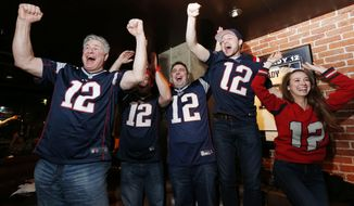 Fans at a Boston bar celebrate after the New England Patriots defeated the Atlanta Falcons in the NFL Super Bowl 51 football game in Houston, Sunday, Feb. 5, 2017. The Patriots won 34-28. (AP Photo/Michael Dwyer)