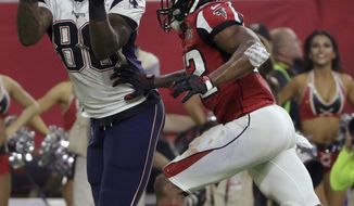 New England Patriots' Martellus Bennett eyes the ball under pressure from Atlanta Falcons' Keanu Neal, during the second half of the NFL Super Bowl 51 football game Sunday, Feb. 5, 2017, in Houston. (AP Photo/Matt Slocum)