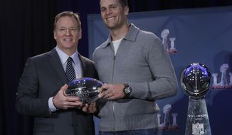 NFL commissioner Roger Goodell and New England Patriots quarterback Tom Brady pose during a news conference after the NFL Super Bowl 51 football game Monday, Feb. 6, 2017, in Houston. (AP Photo/Morry Gash)