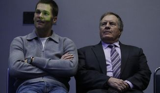 New England Patriots head coach Bill Belichick and Tom Brady wait to be introduced during a news conference after the NFL Super Bowl 51 football game Monday, Feb. 6, 2017, in Houston. (AP Photo/Morry Gash)