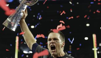 New England Patriots' Tom Brady hoists the Vince Lombardi Trophy after the NFL Super Bowl 51 football game against the Atlanta Falcons Sunday, Feb. 5, 2017, in Houston. The New England Patriots won 34-28 in overtime. (AP Photo/David J. Phillip)