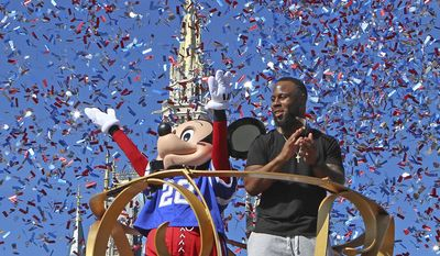 New England Patriots' James White participates in a celebration parade, Monday, Feb. 6, 2017 at the Magic Kingdom in Orlando, Fla. White, a day after from a record-setting Super Bowl performance including the game-winning score waves to the enthusiastic crowd. (Red Huber/Orlando Sentinel via AP)