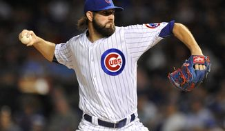 FILE - In this Sept. 19, 2016, file photo, Chicago Cubs starter Jason Hammel delivers a pitch during the first inning of a baseball game against the Cincinnati Reds in Chicago. The Kansas City Royals and Hammel have agreed to a $16 million, two-year contract, a person with direct knowledge negotiations told The Associated Press. The person spoke on condition of anonymity Monday, Feb. 6, 2017, because the deal is pending a physical. (AP Photo/Paul Beaty, File)