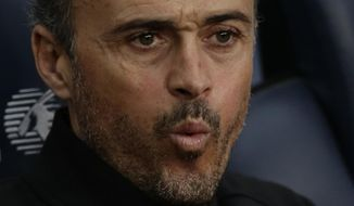FC Barcelona's coach Luis Enrique gestures during the Spanish La Liga soccer match between FC Barcelona and Athletic Bilbao at the Camp Nou in Barcelona, Spain, Saturday, Feb. 3, 2017. (AP Photo/Manu Fernandez)