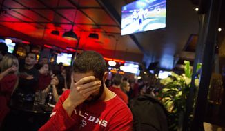 Michael Mazza reacts after the New England Patriots scored late in the fourth quarter against the Atlanta Falcons in the NFL Super Bowl 51 football game being played in Houston while watching it on television at Fado Irish Pub in Atlanta, Sunday, Feb. 5, 2017. Falcons fans are in the somber mood Monday after their team blew a 25-point lead in a 34-28 defeat to the New England Patriots the night before. (AP Photo/David Goldman, File)