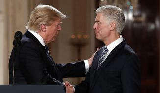 In this Jan. 31, 2017, file photo, President Donald Trump shakes hands with 10th U.S. Circuit Court of Appeals Judge Neil Gorsuch, his choice for Supreme Court associate justice in the East Room of the White House in Washington. (AP Photo/Carolyn Kaster)