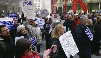 Environmental Protection Agency employees and environmental activists gather in Chicago, Monday, Feb. 6, 2017, to protest the nomination of Scott Pruitt for administrator of the agency. Pruitt is President Donald Trump's pick to head the agency. (AP Photo/Carla K. Johnson)