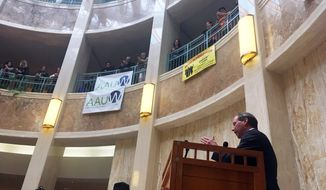 "Sen. Tom Udall, D-New Mexico, speaks to immigrant rights advocates at the New Mexico Statehouse in Santa Fe, N.M., Monday, Feb. 6, 2017. Udall told advocates on Monday that President Donald Trump's travel ban on seven Muslim-majority countries is ""illegal and unconstitutional"" and vowed to fight it with other Democratic senators. (AP Photo/Russell Contreras)"