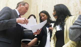 "Sen. Tom Udall, D-N.M., left, speaks to immigrant rights advocates at the Statehouse in Santa Fe, N.M., Monday, Feb. 6, 2017. Udall told advocates on Monday that President Donald Trump's travel ban on seven Muslim-majority countries is ""illegal and unconstitutional"" and vowed to fight it with other Democratic senators. (AP Photo/Russell Contreras)"