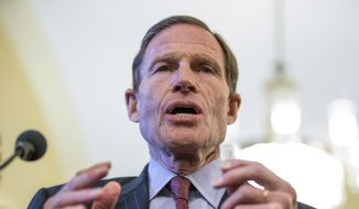 Sen. Richard Blumenthal, D-Conn., holds a thumb drive during a news conference on Capitol Hill in Washington, Tuesday, Feb. 7, 2017, with petitions calling for the Senate to reject Attorney General-designate Sen. Jeff Sessions, R-Ala. (AP Photo/Andrew Harnik) ** FILE **