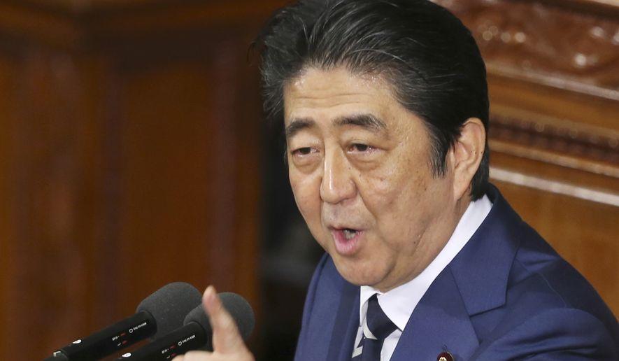 Japanese Prime Minister Shinzo Abe speaks in Tokyo, in this Jan. 20, 2016, file photo. A White House spokesman says President Donald Trump will host Prime Minister Shinzo Abe at Mar-a-Lago this weekend. (AP Photo/Koji Sasahara, File)