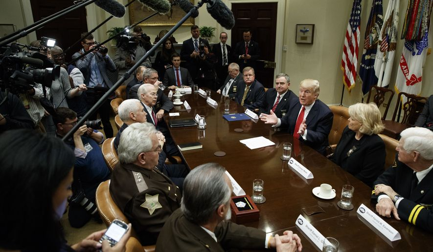 President Donald Trump speaks during a meeting with county sheriffs in the Roosevelt Room of the White House in Washington, Tuesday, Feb. 7, 2017. (AP Photo/Evan Vucci)