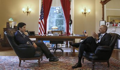 Senate President Kevin de Leon, D-Los Angeles, left, mets with former U.S. Attorney General Eric Holder, Tuesday, Feb. 7, 2017, in Sacramento, Calif. Holder has been hired by Democratic leaders of California's Legislature to represent them in legal issues against President Donald Trump and his administration. Holder met with de Leon, Assembly Speaker Anthony Rendon, D- Paramount, and Gov. Jerry Brown during his visit. (AP Photo/Rich Pedroncelli)