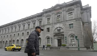 A man walks outside of the 9th U.S. Circuit Court of Appeals in San Francisco, Tuesday, Feb. 7, 2017. President Donald Trump's travel ban faced its biggest legal test yet Tuesday as a panel of federal judges prepared to hear arguments from the administration and its opponents about two fundamentally divergent views of the executive branch and the court system. (AP Photo/Jeff Chiu)