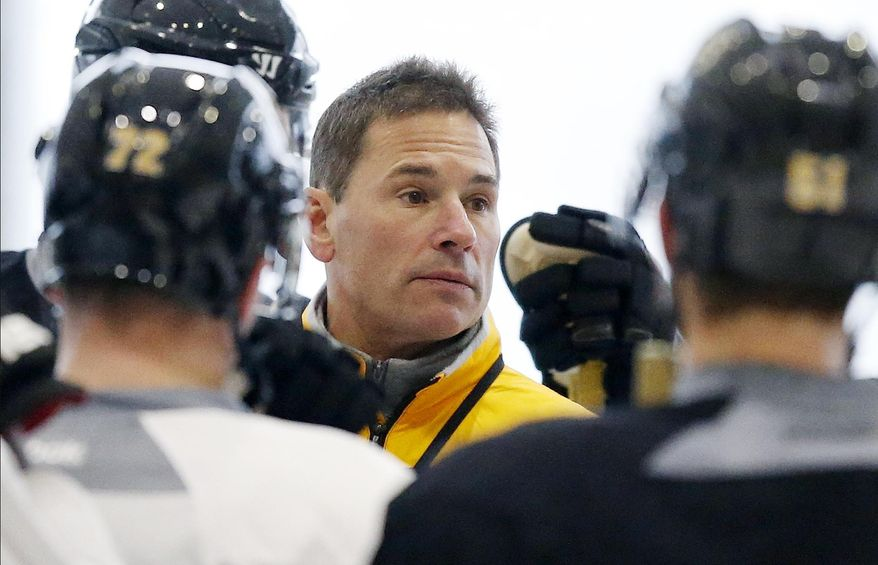 Bruce Cassidy talks with players during Boston Bruins hockey practice in Boston, Tuesday, Feb. 7, 2017. Cassidy was named interim coach after the Bruins fired Stanley Cup-winning coach Claude Julien on Tuesday. (AP Photo/Michael Dwyer)