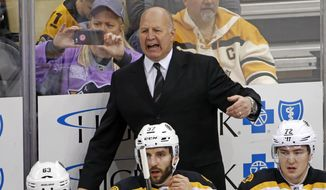FILE - In this Jan. 22, 2017 file photo, Boston Bruins head coach Claude Julien motions to an official during the first period of an NHL hockey game against the Pittsburgh Penguins in Pittsburgh. On Tuesday, Feb. 7, 2017, the Bruins fired Julien, who was in his 10th season as head coach, and named assistant Bruce Cassidy interim coach. (AP Photo/Gene J. Puskar, File)