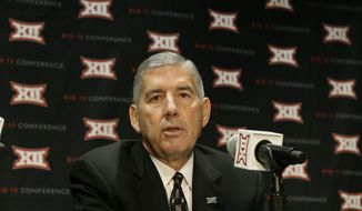 FILE - In this Oct. 17, 2016 file photo, Big 12 Commissioner Bob Bowlsby speaks to reporters after The Big 12 Conference meeting in Grapevine, Texas.  Two years ago, the NCAA passed a proposal that encouraged college football to embrace technology by putting tablet computers on sidelines and cameras in helmets. Two years later, college football is still behind the times when it comes to using technology to coach players during games. (AP Photo/LM Otero)