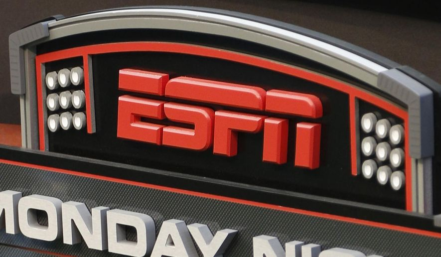 FILE - This Sept. 16, 2013, file photo shows the ESPN logo prior to an NFL football game between the Cincinnati Bengals and the Pittsburgh Steelers, in Cincinnati. Disney stands at a crossroads after years of chugging along on the strength of well-known characters and the popular ESPN sports network. But its CEO might soon retire, while many of its traditional businesses are having to adapt to new online-driven realities. (AP Photo/David Kohl, File)