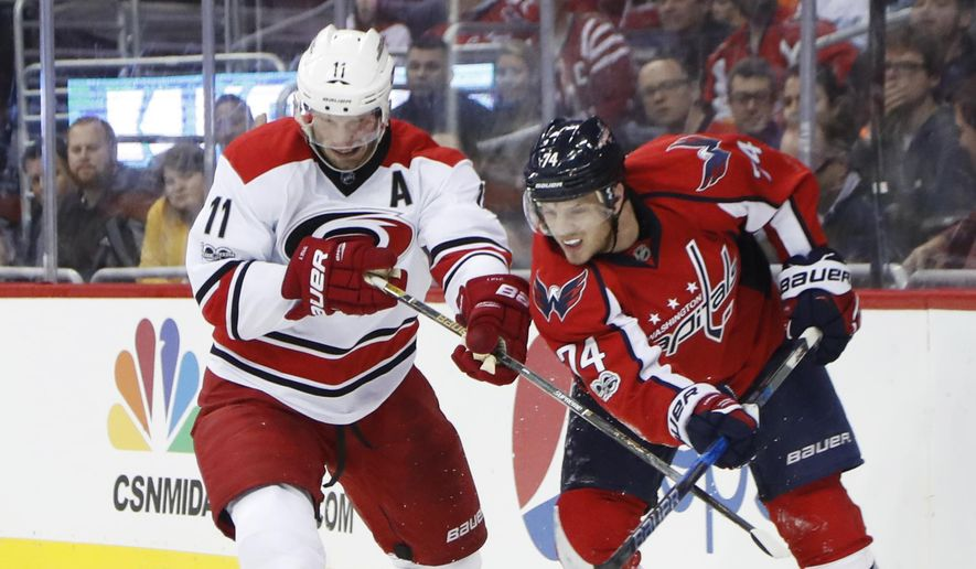 Carolina Hurricanes center Jordan Staal (11) and Washington Capitals defenseman John Carlson (74) goes after the puck during the first period of an NHL hockey game in Washington, Tuesday, Feb. 7, 2017. (AP Photo/Manuel Balce Ceneta) **FILE**