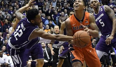 Northwestern guard Isiah Brown (12) defends Illinois guard Te'Jon Lucas (3) during the first half of an NCAA college basketball game Tuesday, Feb. 7, 2017, in Evanston, Ill. (AP Photo/David Banks)