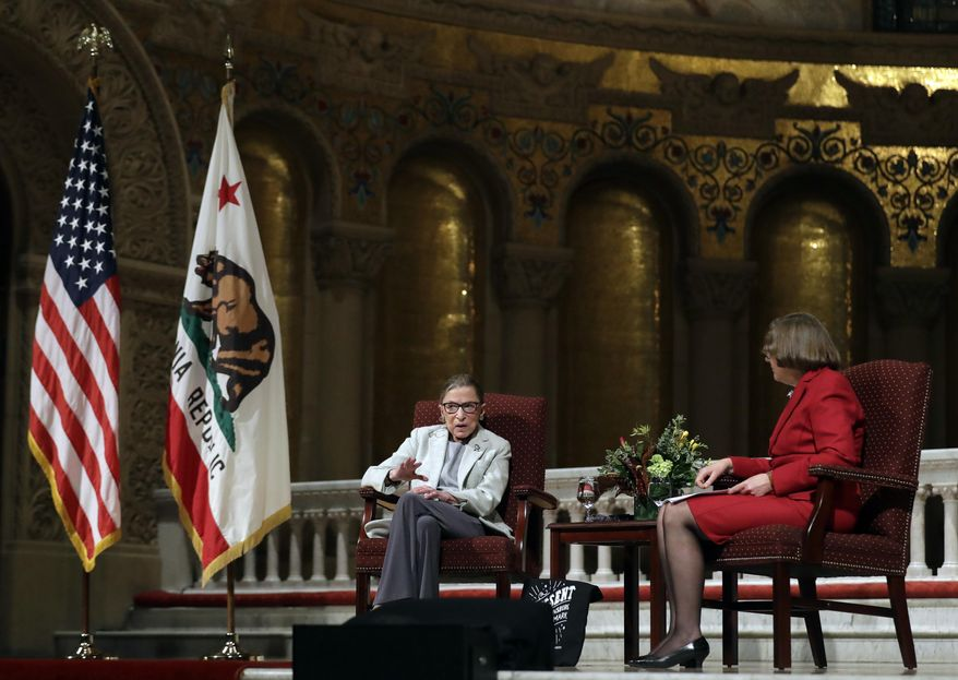 U.S. Supreme Court Justice Ruth Bader Ginsburg, center, sits down with Jane Shaw, at right, Stanford University's Dean of Religious Life, Monday, Feb. 6, 2017, in Stanford, Calif. (AP Photo/Marcio Jose Sanchez)