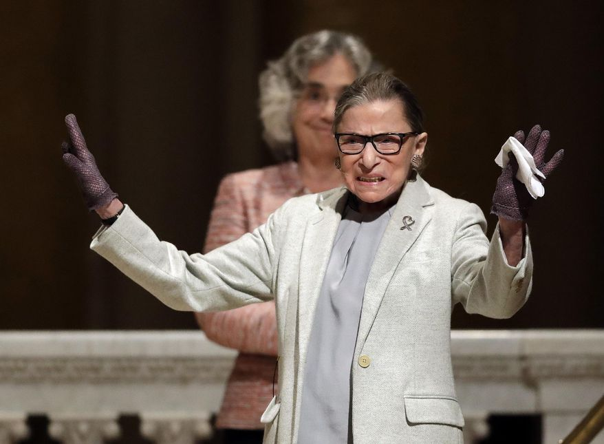 U.S. Supreme Court Justice Ruth Bader Ginsburg waves as she is introduced during a visit to Stanford University, Monday, Feb. 6, 2017, in Stanford, Calif. (AP Photo/Marcio Jose Sanchez)