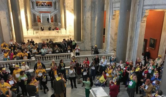 In this file photo, demonstrators organized by Kentuckians For The Commonwealth chant outside the state Senate chambers in Frankfort, Ky., Tuesday, Feb. 7, 2017. (AP Photo/Adam Beam) **FILE**
