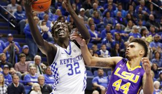 Kentucky's Wenyen Gabriel (32) shoots while pressured by LSU's Wayde Sims (44) during the first half of an NCAA college basketball game, Tuesday Feb. 7, 2017, in Lexington, Ky. (AP Photo/James Crisp)