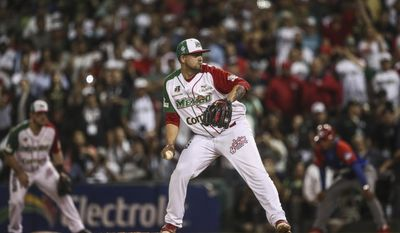 Mexico's Aguilas de Mexicali Jake Sanchez prepare to throws the ball during the Caribbean Series game against Cuba's Granma in Culiacan, Mexico, Monday, Feb. 6, 2017. Mexico held off Cuba 1-0 on Monday to reach the Caribbean Series championship game where they will face Puerto Rico. (AP Photo/Luis Gutierrez)