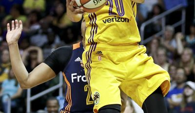File- This June 26, 2016, file photo shows Los Angeles Sparks guard Kristi Toliver shoots against the Connecticut Sun during the second half of an WNBA basketball game in Los Angeles. The Washington Mystics have signed free agent guard Toliver. The move on Tuesday, Feb.7, 2017, caps a busy week for the Mystics, who traded for former league MVP Elena Delle Donne on Thursday. Washington also traded away Kia Vaughn and Bria Hartley to clear salary cap space to sign Toliver. (AP Photo/Chris Carlson, File)