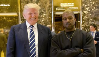 Then-President-elect Donald Trump and Kanye West pose for a picture in the lobby of Trump Tower in New York, in this Dec. 13, 2016, file photo. West has deleted tweets posted on Dec. 13, 2016, explaining the meeting. (AP Photo/Seth Wenig, File)