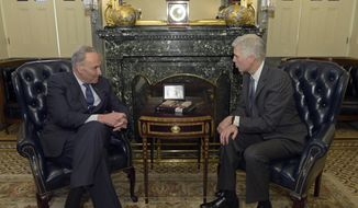 Senate Minority Leader Charles Schumer of N.Y. meets with Supreme Court nominee Neil Gorsuch on Capitol Hill in Washington, Tuesday, Feb. 7, 2017. (AP Photo/Susan Walsh)