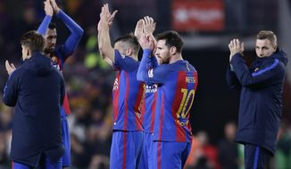 Barcelona's Lionel Messi, center right, and his teammates applaud the supporters at the end of the the Copa del Rey semifinal second leg soccer match between FC Barcelona and Atletico Madrid at the Camp Nou stadium in Barcelona, Spain, Tuesday Feb. 7, 2017. The game ended in a 1-1 draw and Barcelona advances to the final after a first leg 2-1 win. (AP Photo/Manu Fernandez)