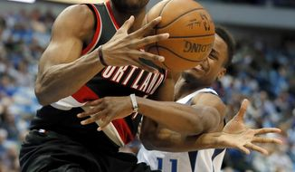 Portland Trail Blazers' Maurice Harkless (4) maintains control of the ball on the way to the basket under pressure from Dallas Mavericks' Yogi Ferrell, right, during the first half of an NBA basketball game in Dallas, Tuesday, Feb. 7, 2017. (AP Photo/Tony Gutierrez)